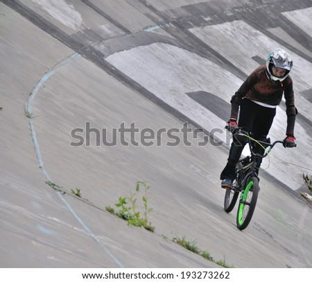 KIEV, UKRAINE � 17 MAY 2014: Unkonwn cyclist tests a cyclie on the old cycle track on May 17, 2014 in Kiev, Ukraine