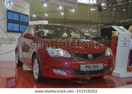 KIEV, UKRAINE - MAY 29: Visitors visit new Morris Garages MG 350 car model on display of SIA' 2013 Kyiv International Motor Show in International Exhibition Centre on May 29, 2013 in Kiev, Ukraine. - stock photo