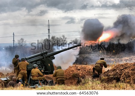 KIEV, UKRAINE - NOV 7: A members of military history club wears historical Soviet uniform& air defense cannon during historical reenactment of WWII,November 7, 2010 in Kiev, Ukraine - stock photo