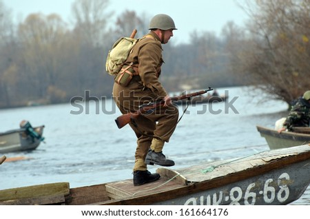 KIEV, UKRAINE -NOV 3: An unidentified member of Red Star history club wears historical CZECH uniform during historical reenactment of WWII, Battle for Kiev 1943 on November 3, 2013 in Kiev, Ukraine