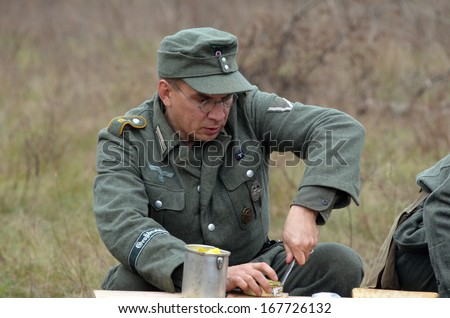 KIEV, UKRAINE -NOV 2: An unidentified member of Red Star history club wears historical German uniform during historical reenactment of WWII, Dnepr river crossing 1943, November 2, 2013. Kiev, Ukraine
