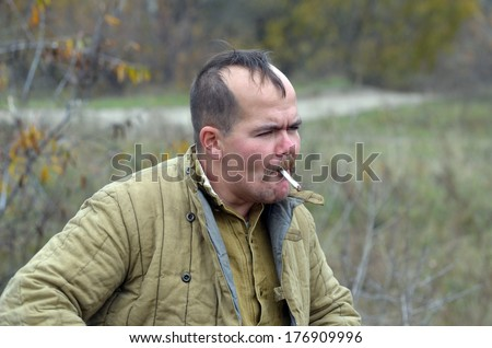 KIEV, UKRAINE -NOV 1: An unidentified member of Red Star history club wears historical Soviet uniform during historical reenactment of WWII, Dnepr river crossing 1943, November 1, 2013 Kiev, Ukraine  - stock photo