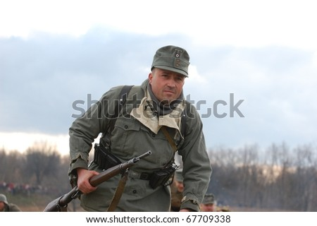 KIEV, UKRAINE - NOV 7: member of Red Star history club wears historical German uniform during historical reenactment of Kiev Liberation in 1943, November 7, 2010 in Kiev, Ukraine
