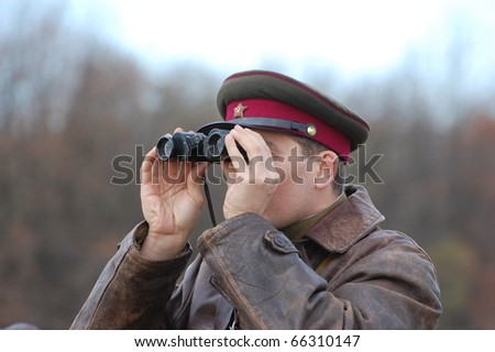 KIEV, UKRAINE - NOV 7: Member of Red Star history club wears historical Soviet uniform during historical reenactment of Kiev Liberation in 1943, November 7, 2010 in Kiev, Ukraine