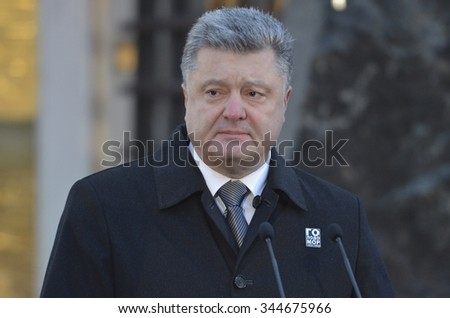 KIEV, UKRAINE - Nov 28, 2015: President of Ukraine Petro Poroshenko and his wife commemorated the victims of the famine-genocide of 1932-1933 in Ukraine