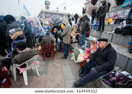 KIEV, UKRAINE - NOV 28: Senior couple of the demonstrators who occupide Euro Maidan square & require the government to join EU and sign the Accession to the European Union on November 28, 2013 in Kiev