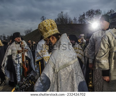 KIEV, UKRAINE - November 22, 2014:  Patriarch Filaret -- President of Ukraine with wife, Kiev citizens and representatives of all religions confessions come to Memorial of victims of the Holodomor - stock photo