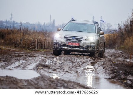KIEV, UKRAINE - 14 NOVEMBER : Presentation of the car Subaru Outback restyling. Tests in difficult road conditions on a special track for offroad. 14 november 2015, Kiev, Ukraine.