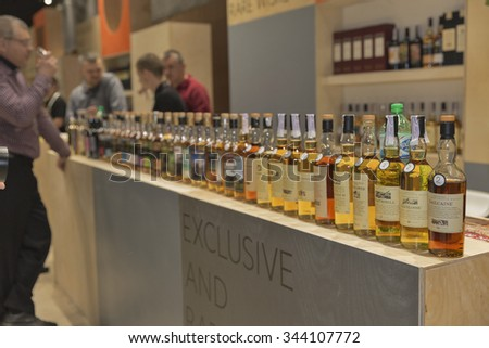 KIEV, UKRAINE - NOVEMBER 21, 2015: Unrecognized people visit Good Wine Exclusive and Rare Single Malt Scotch Whiskey booth at 1st Ukrainian Whisky Dram Festival in Parkovy Exhibition Center.