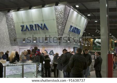 KIEV, UKRAINE - NOVEMBER 17: Visitors visit Jewellery House ZARINA booth (ZARINA GROUP SA) during Autumn Jeweller Expo at KyivExpoPlaza Exhibition Center on November 17, 2011 in Kiev, Ukraine. - stock photo