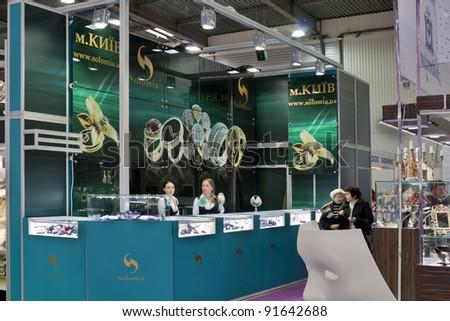 KIEV, UKRAINE - NOVEMBER 17: Visitors visit Vinnitsa Solomia Jewelry company booth during Autumn Jeweler Expo exhibition at KyivExpoPlaza Exhibition Center on November 17, 2011 in Kiev, Ukraine. - stock photo