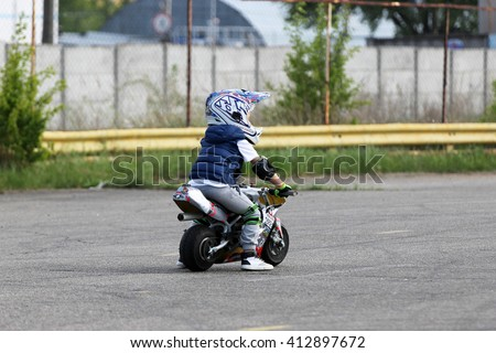 Kiev, Ukraine - Now 22: A child rides a motorcycle. Extreme riding, on Now 22, 2015 in Kiev, Ukraine