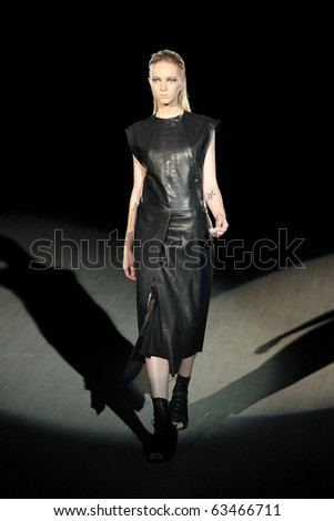 "KIEV, UKRAINE - OCT 16: Model poses at the runway during Fashion Show by ""LITKOVSKAYA"" by fashion designer of Liliya litkovskaya as part of Ukrainian Fashion Week, October 16, 2010 in Kiev, Ukraine."