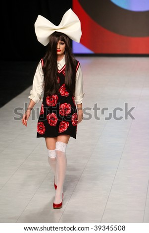 "KIEV, UKRAINE - OCT 15: Model poses at the runway during Fashion Show by ""ZALEVSKIY"" as part of Ukrainian Fashion Week, October 15, 2009 in Kiev, Ukraine."
