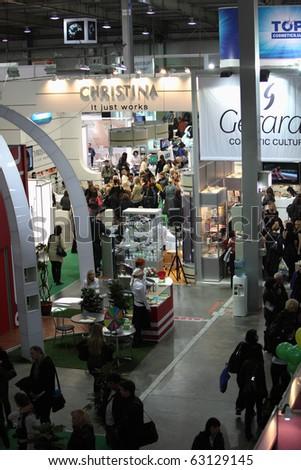 "KIEV, UKRAINE - OCTOBER 14: Congress of the beauty industry ""ESTET BEAUTY EXPO 2010"". Interior of large hall of exhibition KIEV EXPO PLAZA on October 14, 2010 in Kiev, Ukraine. - stock photo"
