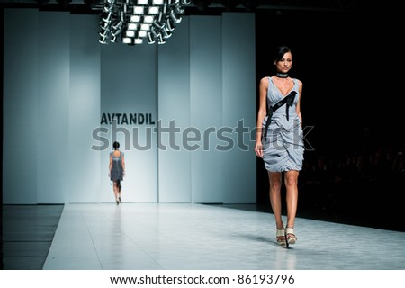 "KIEV, UKRAINE - OCTOBER 16: Fashion model wears clothes created by ""AVTANDIL"" at the 24th Ukrainian Fashion Week on Oct. 16, 2009 in Kiev, Ukraine. - stock photo"