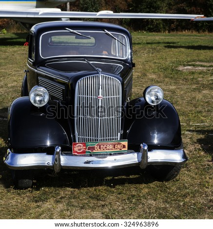 KIEV, UKRAINE - October 2, 2015: Opel, 1937 -- Old Car Land is the biggest retro cars festival held in Kiev, and covers the State Aviation Museum grounds - stock photo