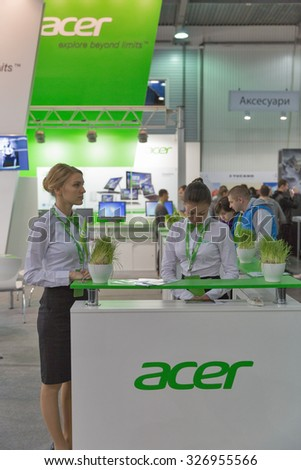 KIEV, UKRAINE - OCTOBER 11, 2015: Presenters work on Acer, a Taiwan based international computer company booth during CEE 2015, largest electronics trade show of Ukraine in ExpoPlaza Exhibition Center