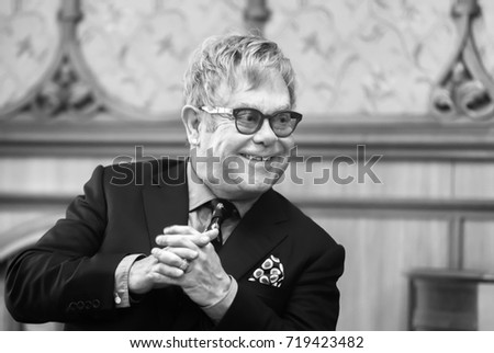 KIEV, UKRAINE - Sep 12, 2015: Black and white portrait of world-famous musician, composer and singer Elton John during his meeting with President of Ukraine Petro Poroshenko