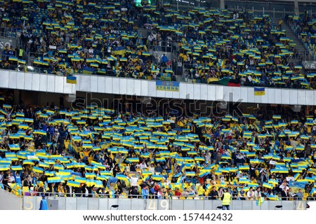 KIEV, UKRAINE - SEP 10: Fans of the Ukrainian team at the stadium during the qualifying match 2014 World Cup between Ukraine vs England, 10 September 2013, NSC Olympic Stadium, Kiev, Ukraine