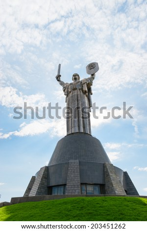 KIEV, UKRAINE - SEP 11, 2013: Monumental statue Mother Motherland built by Yevgeny Vuchetich opened in 1981 year at The Ukrainian State Museum of the Great Patriotic War.  - stock photo