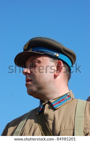 KIEV, UKRAINE -SEPT 17 : A member of Red Star history club wears historical Soviet Air Force uniform during historical reenactment of WWII, September 17, 2011 in Kiev, Ukraine