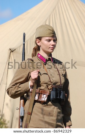 KIEV, UKRAINE -SEPT 17 : A member of Red Star history club wears historical Soviet uniform during historical reenactment of WWII, September 17, 2011 in Kiev, Ukraine