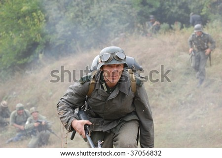 KIEV, UKRAINE - SEPT 6, : Members of a history club wear historical German uniforms as they participates in a WWII reenactment.Defense Kiev in 1941. September 6 , 2009 in Kiev, Ukraine