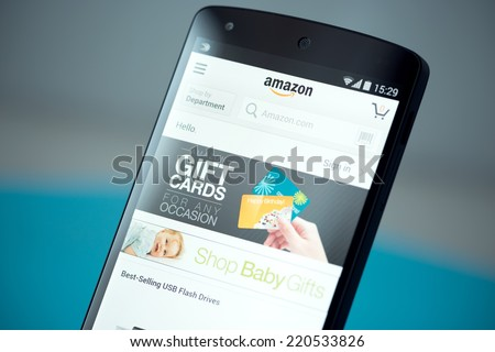 Kiev, Ukraine - September 22, 2014: Clouse-up shot of brand new Google Nexus 5, powered by Android 4.4 version, with Amazon website page on a screen.  - stock photo