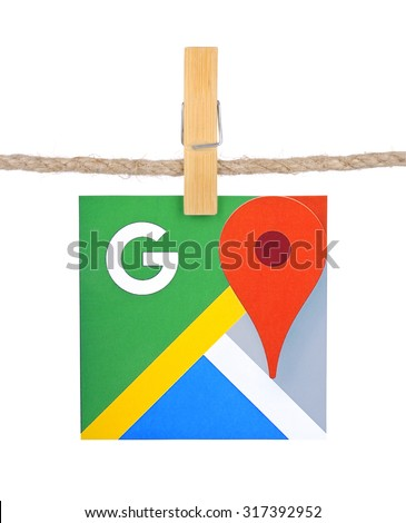 KIEV, UKRAINE - SEPTEMBER 16, 2015:Logo Google  Maps  hanging on the clothesline isolated on white background.Google Maps  set of applications map service and technology provided by the company Google