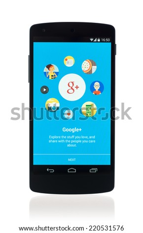 Kiev, Ukraine - September 12, 2014: Studio shot of brand new Google Nexus 5, powered by Android 4.4 version, with Google Plus mobile application on a screen. Isolated on white background. - stock photo