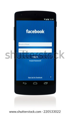 Kiev, Ukraine - September 12, 2014: Studio shot of brand new Google Nexus 5, powered by Android 4.4 version, with Facebook mobile application on a screen. Isolated on white background.  - stock photo