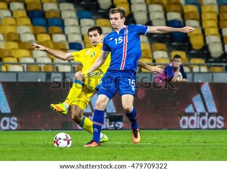 KIEV, UKRAINE - SEPTEMBER 5, 2016: Ukrainian midlefielder Taras Stepanenko in the fight for the ball against Jon DADI BODVARSSON from Iceland during the match qualifying for the FIFA World Cup 2018