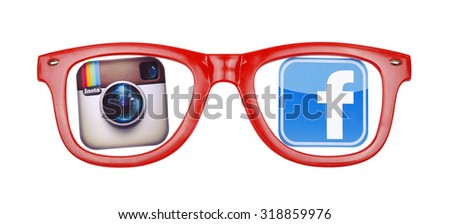 KIEV, UKRAINE - SEPTEMBER 21, 2015: View through the red  glasses popular social media logos with Facebook and Instagram. - stock photo