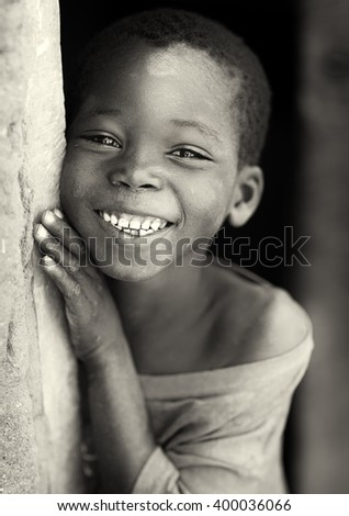KIGOMA - TANZANIA - JULY 5, 2015: Unidentified student in primary school on July 5, 2015 in Kigoma, Tanzania. Tanzania has still an alarming drop-out rate of students in primary school - stock photo