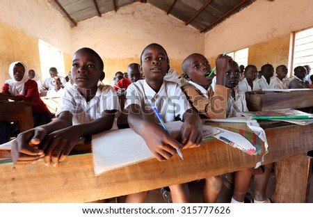 KIGOMA - TANZANIA - JULY 9, 2015: Unidentified students in primary school on July 9, 2015 in Kigoma, Tanzania. Tanzania has still an alarming drop-out rate of students in primary school