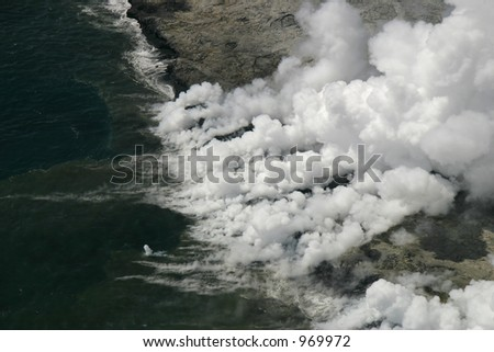 Kilauea lava flow enters ocean. Forty-four acres of the volcanic shelf pictured collapsed into the ocean five days later on Nov. 28, 2005. (Hawaii Volcanoes National Park) - stock photo