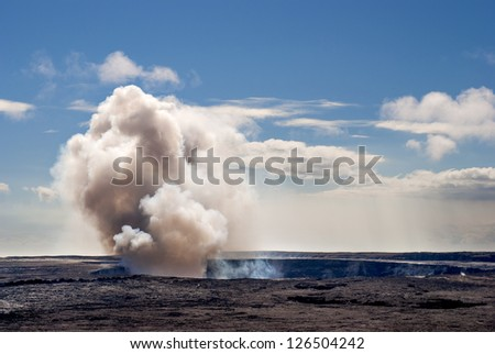 Kilauea Volcano on the Big Island of Hawaii and its toxic gas plume rising into the atmosphere. - stock photo