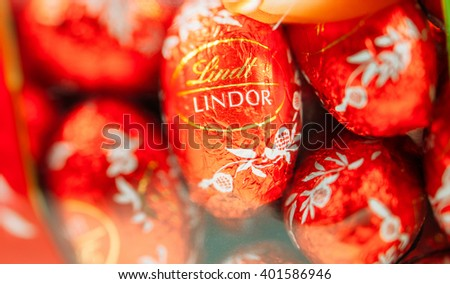 KILCHBERG, SWITZERLAND - MARCH 20, 2014: Lindt Lindor chocolate truffle easter egg chocolate. Lindt is one one of the lastgest luxury chocolate and confectionery company worldwide  - stock photo