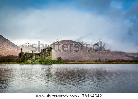 Kilchurn Castle over lake, Scotland - stock photo