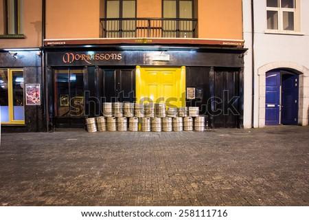KILKENNY, IRELAND - MARCH 27, 2013:  Beer kegs outside pub on the street in Kilkenny Ireland  - stock photo
