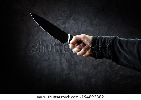 Killer with big knife - person with sharp knife about to commit a homicide, murder scenery.