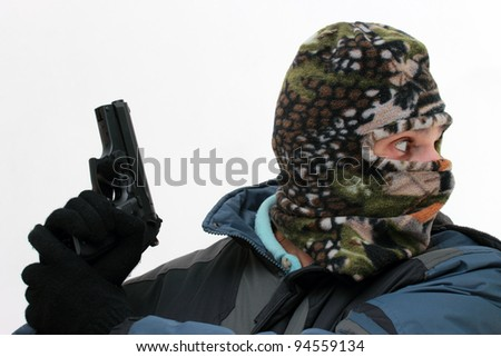 killer with mask and handgun over white