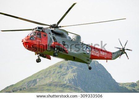 KILLIN, SCOTLAND - JULY 09, 2012: A Royal Navy search and rescue helicopter landing at refuelling station in Killin, Scotland.