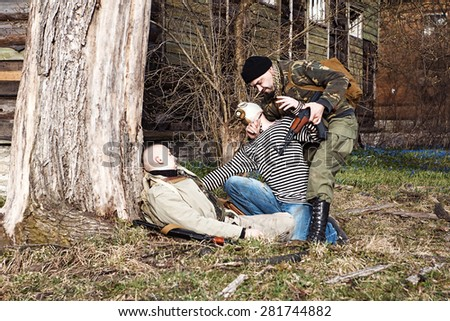 Killing insane zombie which wounded the combatant - stock photo