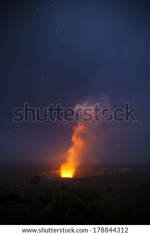 Kiluaea Volcano in Hawaii Volcanoes National Park is one of the most active volcanoes in the world.  On a clear evening, stars glitter all around the volcano. - stock photo