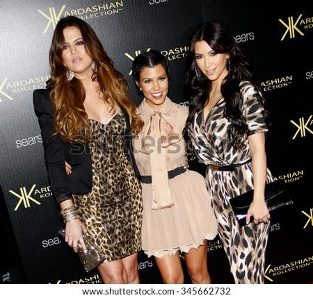 Kim Kardashian, Khloe Kardashian and Kourtney Kardashian at the Kardashian Kollection Launch Party held at the Colony in Hollywood, USA on August 17, 2011. - stock photo