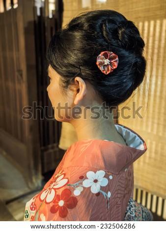 Kimono girl shot from the back - stock photo