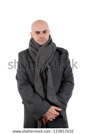 Kind bald man wearing winter tweed coat and long scarf with hands crossed. Isolated. - stock photo