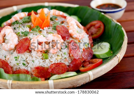 kind of fried rice  so called COM CHIEN DUONG CHAU as typical Vietnamese cuisine made by mix fried of sausage, dried shrimp, egg, rice, pork bologna. - stock photo